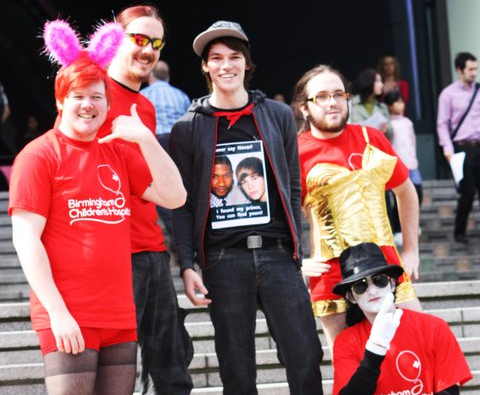 A team of charity abseilers in fancy dress