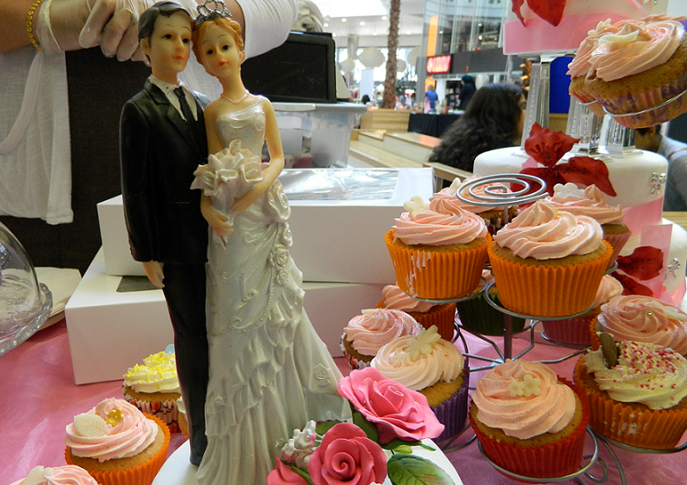 Bride and Groom figures at the Asian Wedding Exhibition at Pavilions Shopping Centre in Birmingham