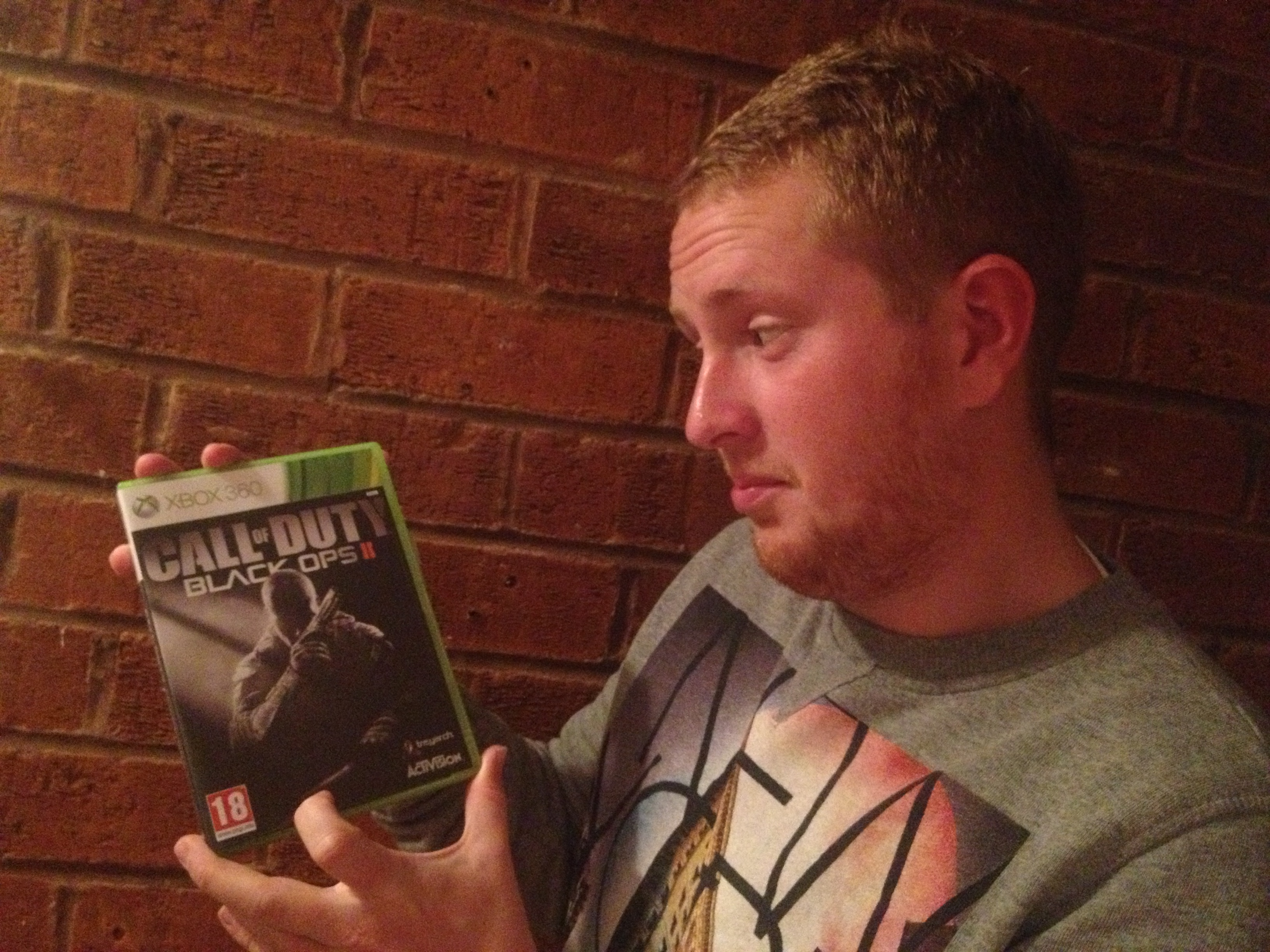 Gaming fan Keiran Loveder, from Sutton Coldfield, with his copy of Call of Duty: Black Ops II