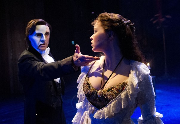 Earl Carpenter as The Phantom and Katie Hall as Christine in The Phantom of the Opera - UK Tour. Photo credit Alistair Muir