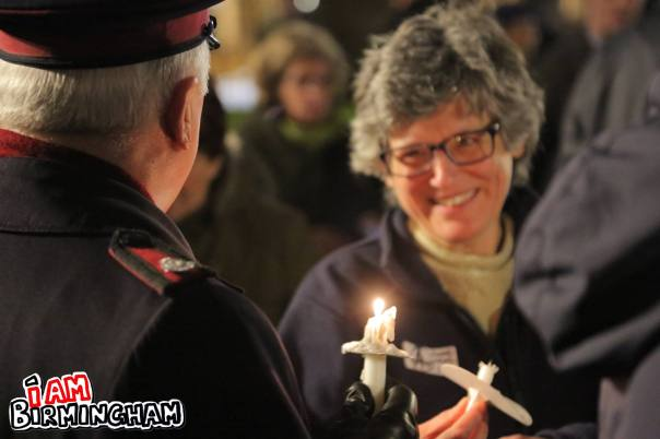 Rabbi Margaret Jacobi shares a moment with a Salvation Army volunteer at the peace vigil in Birmingham (Photograph: Paul Stringer)
