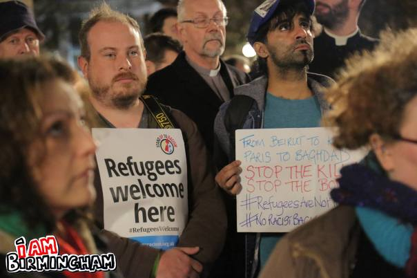 Geoff Dexter and Adam Yosef of Stand Up To Racism Birmingham hold signs at the peace vigil in Birmingham (Photograph: Paul Stringer)