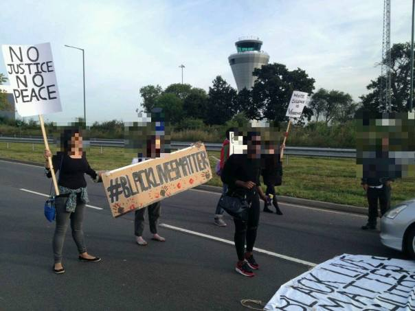 Black Lives Matter activists block a Birmingham road to highlight institutional inequality