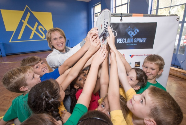 British 400m Olympic Bronze medalist Katherine Merry is helped by pupils to put some of her old trainers into the collection bin during 'Reclaim Sport' Kit Collection Launch at Hillstone Primary School, Birmingham (Photograph: Richard Stonehouse)
