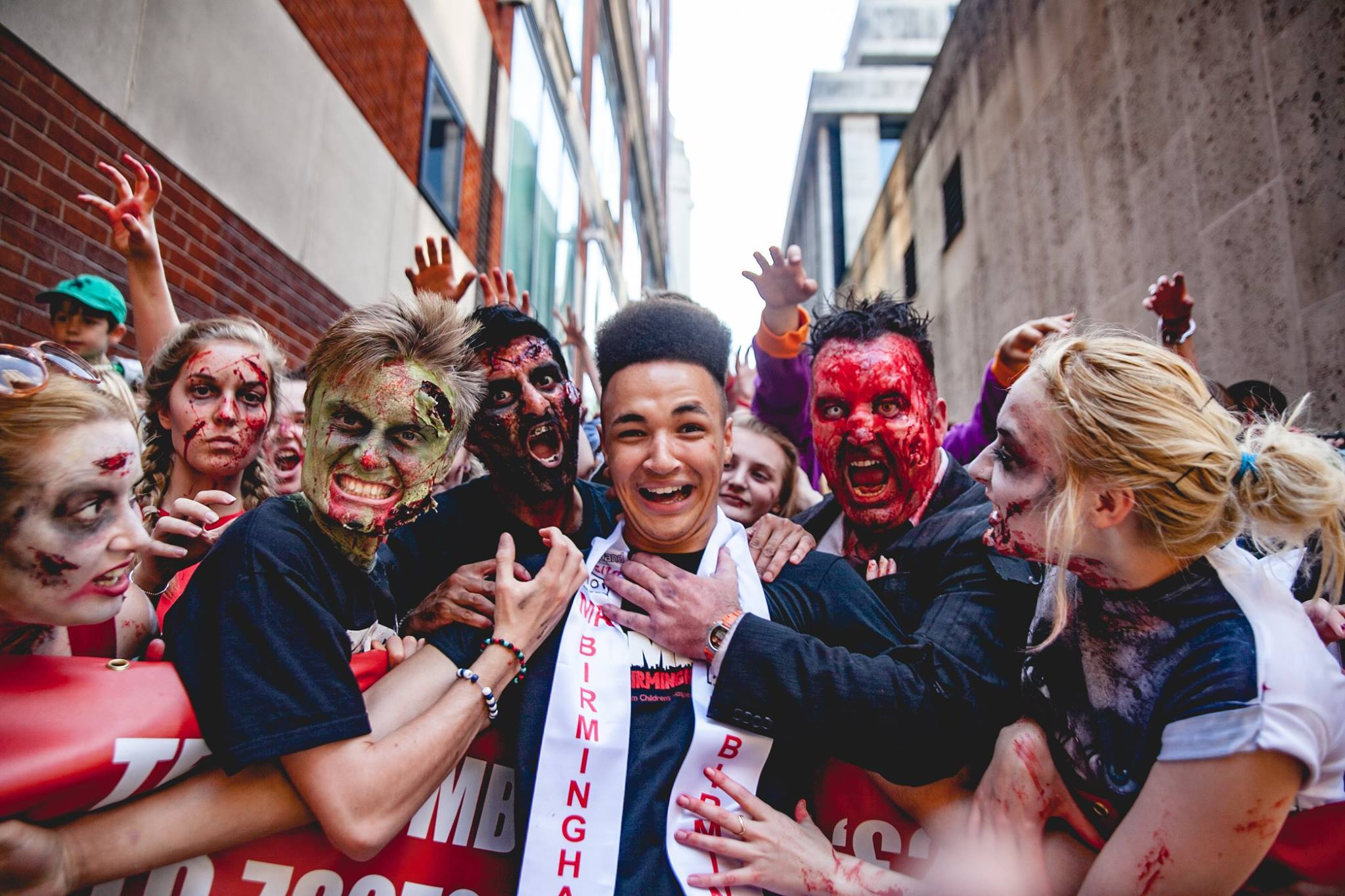 Joshua Williams (centre), aka Mr Birmingham, catches up with some gruesome ghouls at the 2015 Zombie Walk in Birmingham (Photograph: Keiran Fuller/Zombie Walk)
