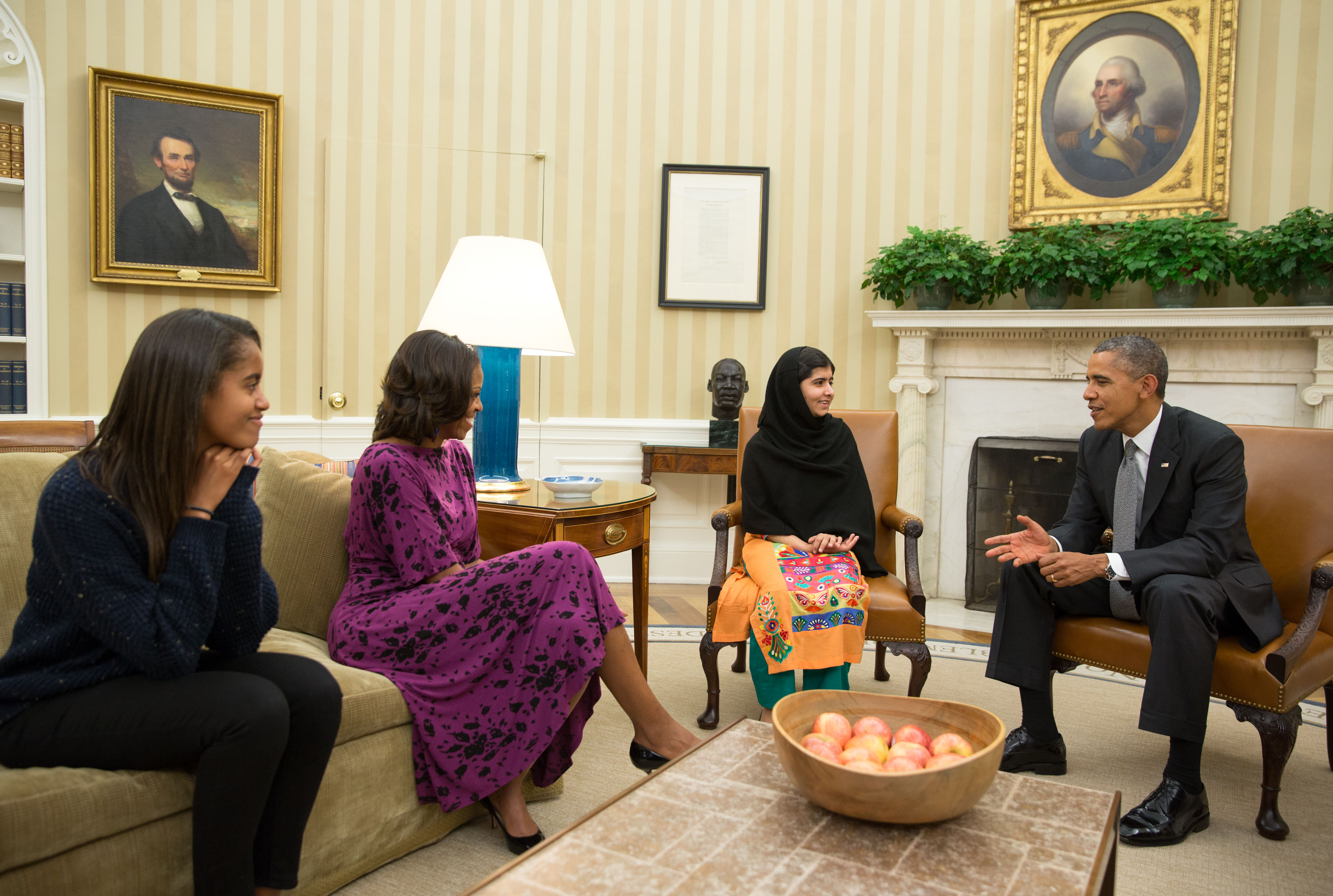 President Barack Obama, First Lady Michelle Obama, and their daughter Malia meet with Malala Yousafzai in the Oval Office, Oct. 11, 2013 (Photograph: Pete Souza/Official White House Photograph)